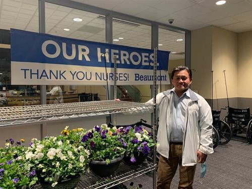 Dr Albaran at Beaumont Troy delivering flowers for Nurse Week 2021