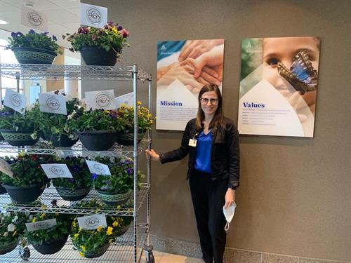 Dr Kolbe at Ascension Providence Rochester delivering flowers for Nurses Week 2021