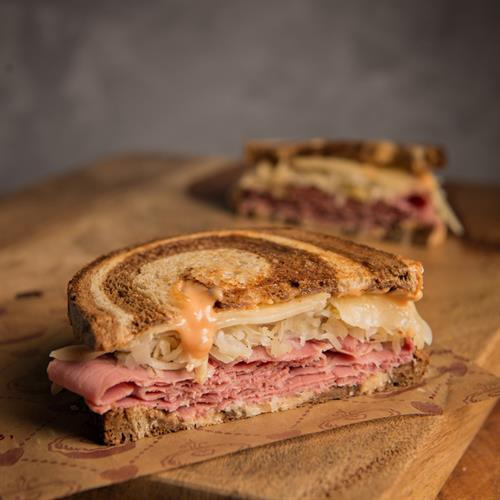 Thinly sliced Michigan corned beef on our Reuben