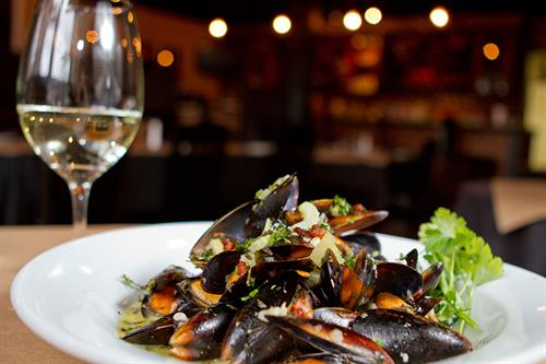 Italian and seafood cuisine at on-site Costa Coastal Kitchen and Bar