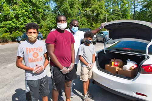 Helping our community with drive through food distribution