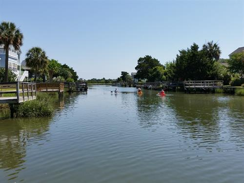 Kayaks on Litchfield Beach tidal canal
