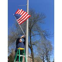 City Lights Committee hangs flags in Dover