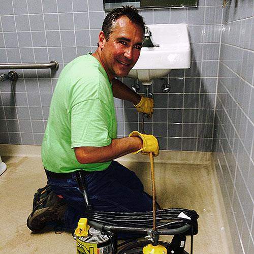 Mark tackling a stubborn restroom sink