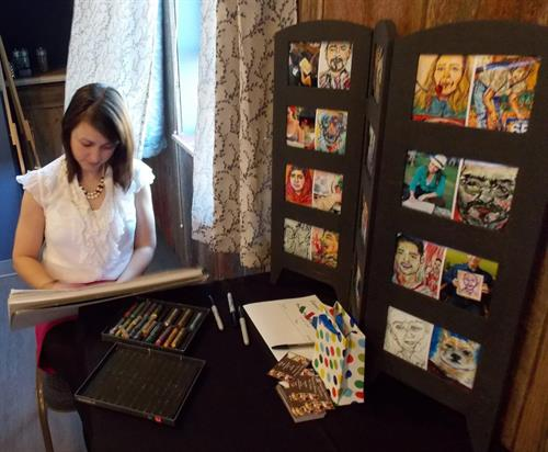 Set up for a hand-rendered, colorful portrait station rquires minimal set up and space.