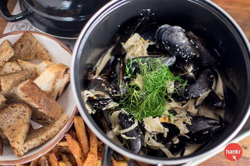 PEI Mussels and Frites in fennel, shallot, preserved lemon, garlic, and Belgian wit ale