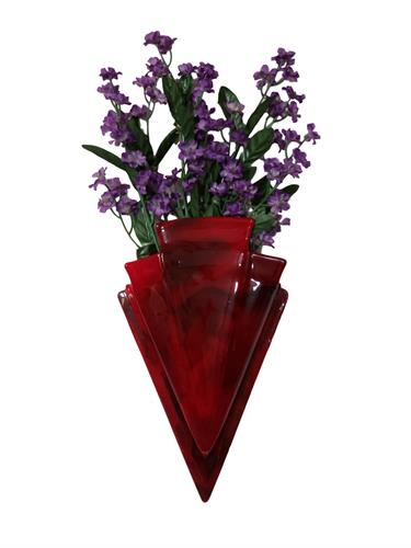 Our hanging wall vase is a special way to honor and remember a loved one. Ashes are displayed in a heart on the back of the vase.