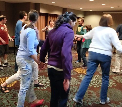 Learning to dance during an Inspiring Hope Workshop.