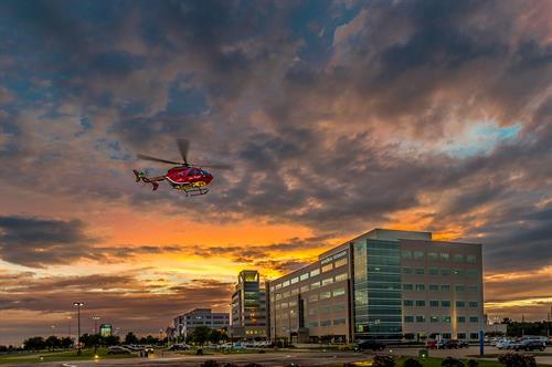 Life Flight landing in front of hospital.
