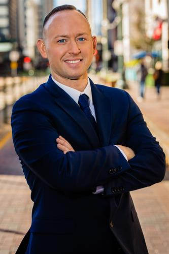 Dustin Harwell- President & CEO