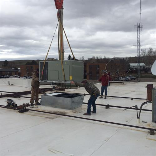 Setting a 5 ton rooftop unit at the Centennial Mall