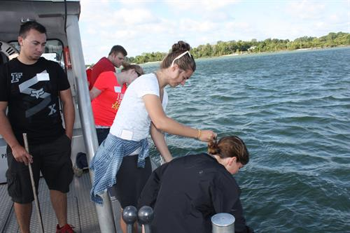 Ohio State Lima students performing experiments at our Stone Laboratory in Put-in-Bay