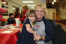 Principal of North Calloway Elementary with future kindergartener at the annual Lakers for Life night.
