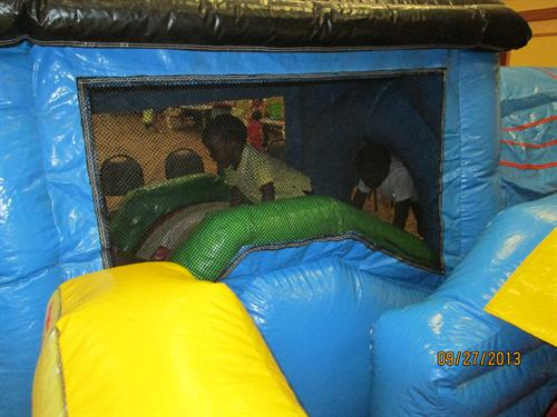 Having fun in an inflatable at a past Early Childhood Fair