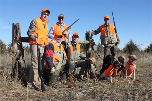 Happy hunters after a successful pheasant drive with our dogs