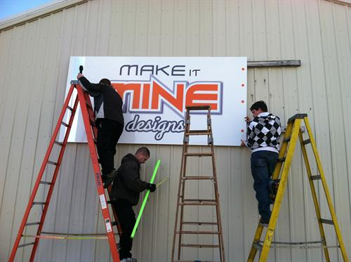 Our sign going up on our old building