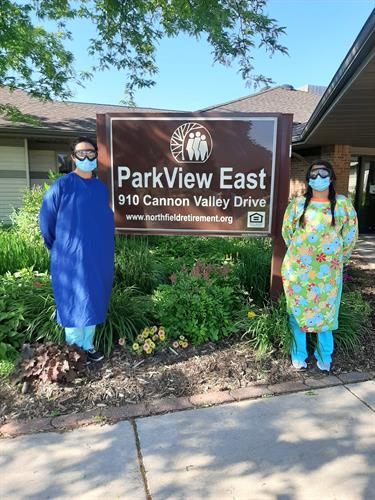 Northfield Retirement Community staff wearing isolation gowns made by volunteers