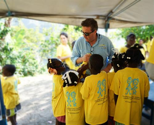 While visiting the children in Haiti, All Children gave each child a new shirt!