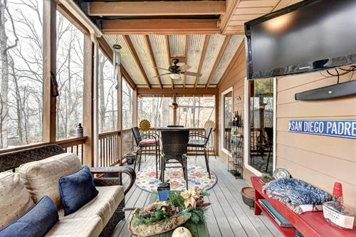 Priced at $359,900. and features this lovely Screened Porch!