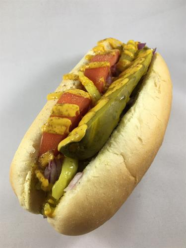 Chicago Dog~ mustard, relish, onions, tomato wedges, sport peppers, a dill pickle spear, and celery salt.