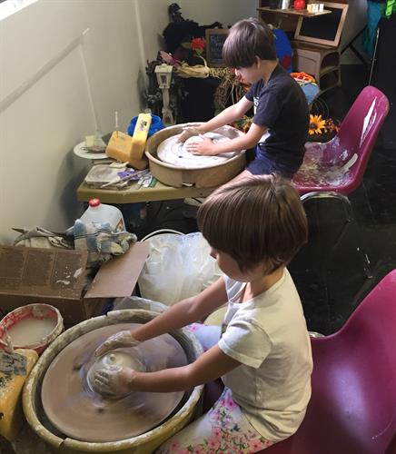 Kids making pots