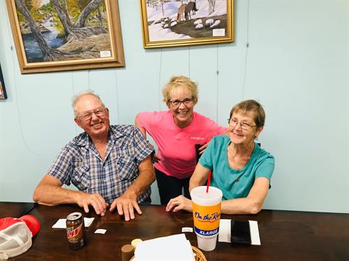 Long time volunteers Clyde and Jo with Director Nancy Montgomery enjoying ice cream on Volunteer Appreciation Day!