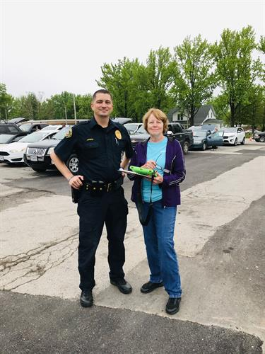 St. James Police Chief Jones and Caring Center Volunteer Renea checking in cars and assisting with parking on Commodity Day