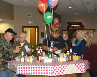 RFCU members enjoy a grilled hot dog lunch at our 2012 International Credit Union Day.