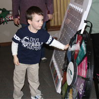 A young RFCU member tries his hand at the wheel at our 2012 International Credit Union Day.