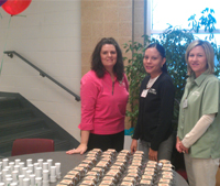 RFCU staff members Dana Marcee, Melinda Barbosa and Gina Wood are ready to give away attendance gifts at our 2013 annual meeting.