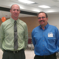 RFCU President Scott Shults and Board Chairman Phil Rufe greet members at our 2013 annual meeting.