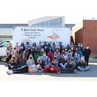 St. James High School participates in a Thanksgiving Food Drive for the Caring Center
