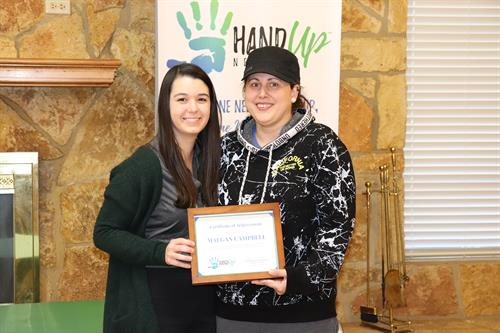 Hand Up Network Client celebrating Mentoring Program Accomplishments