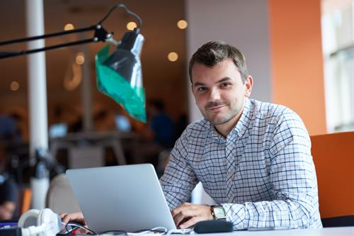 Gallery Image Canva_-_Man_Working_at_His_Desk(1).jpg