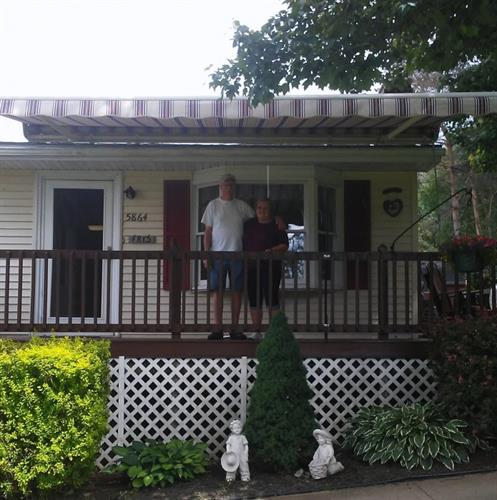 Ken and Phyllis enjoying their new retractable SunSetter roof mount awning at their home near Wooster, Ohio.