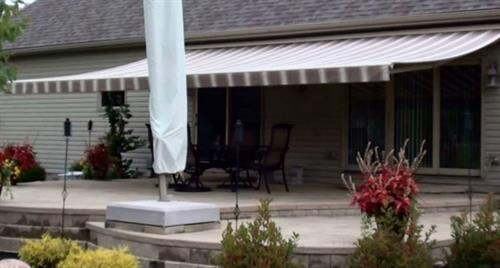 A large awning shades the patio.