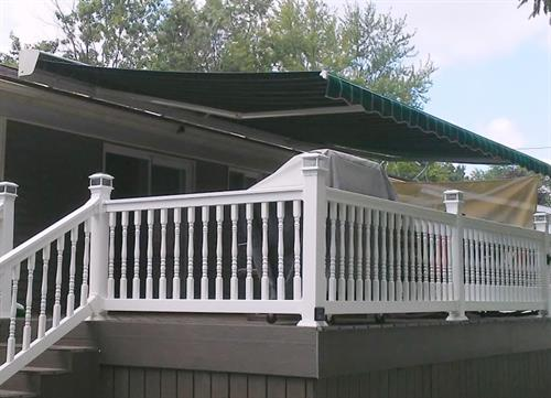This retractable roof-mount awning makes the deck usable and enjoyable all summer long
