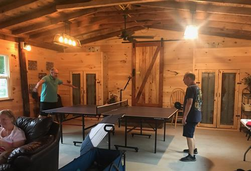 Enjoying a rousting game of ping pong!