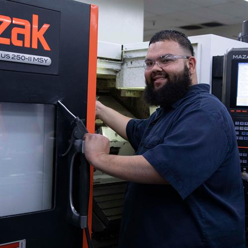 AGM employee working in the machine shop