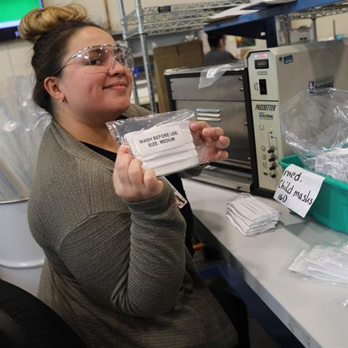 An AGM employee working on the production floor.