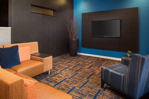 Gallery Image CY_TUSCA_Lobby_Home_Theater.jpg