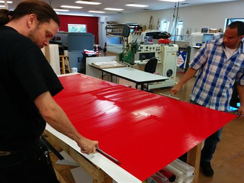 Manufacturing Custom Signs, Banners, Plaques, and much more at our Speedway location.