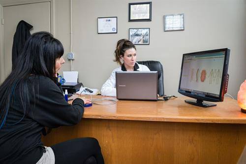 Dr. Anna Blessing.PhD going over a portion of the Biofeedback Scan Results