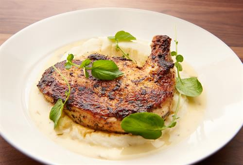 Brick-cooked chicken with pureed potatoes and tarragon butter.