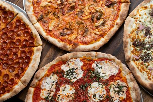 Variety of pizzas at Luigi's West End Pizzeria
