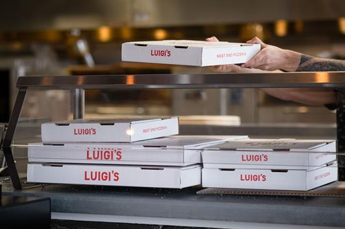 Fresh hot pizza at Luigi's West End Pizzeria