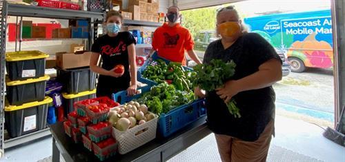 Donating fresh veggies to a food pantry
