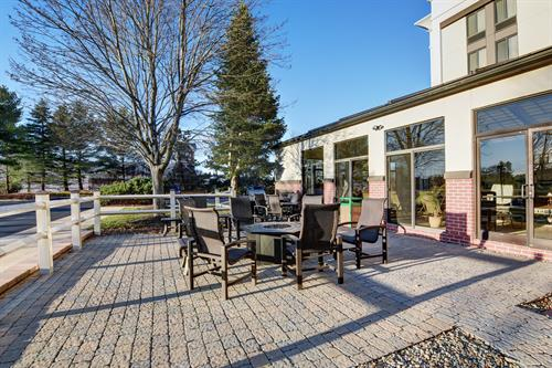 Patio Featuring Two Grills and Fire Pit
