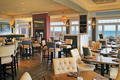 Overview of Shearwater at Stage Neck with Bar, High Top Tables, Banquette Booths, and Oceanfront Dining Tables.