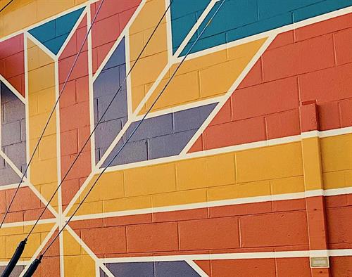 Look for our colorful mural just before the end of High St @ Deer St.